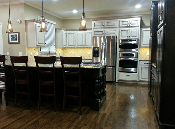 Kitchen Remodeling with two stacked stoves. Johnson County Remodeling.