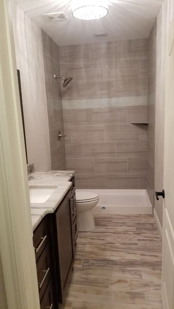 Sink. Shower and stool. Bathroom Remodeling. Olathe Basement Remodeling. Johnson County Remodeling.
