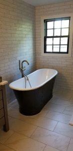 free standing black tub